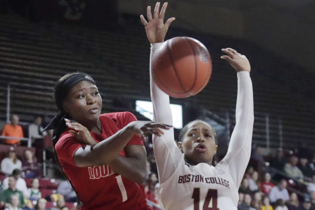 Louisville guard Dana Evans (1) passes the ball away from Boston College guard Marnelle Garraud (14) during the first half of an NCAA college basketball game Thursday, Jan. 16, 2020, in Boston. (AP Photo/Elise Amendola)