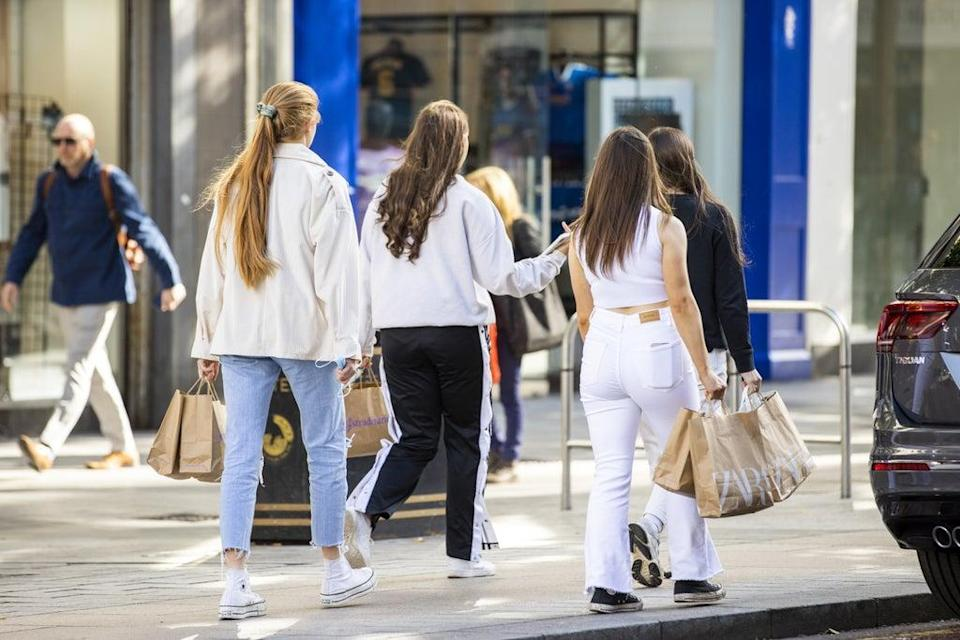 Shoppers on the high street in Belfast (PA) (PA Wire)