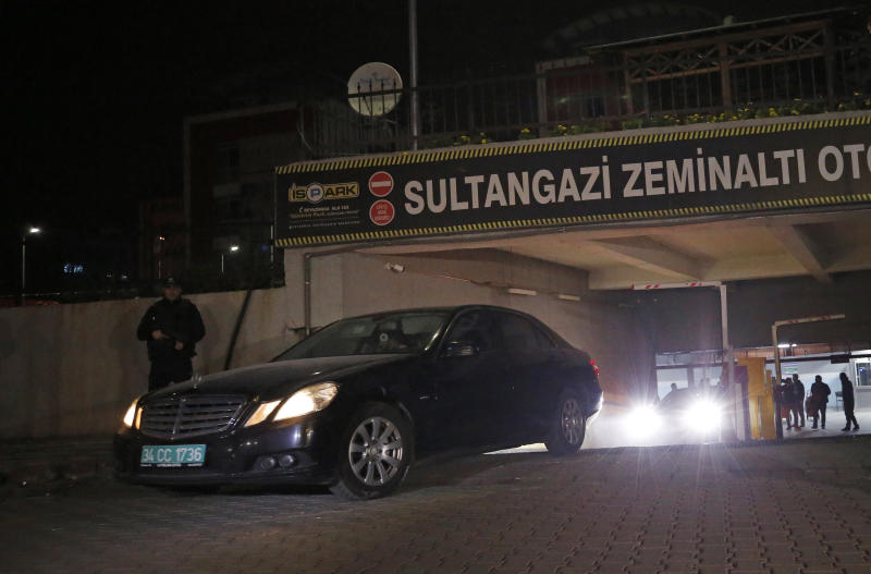 A vehicle belonging to the Saudi consulate found by authorities a day earlier, at an underground park in Istanbul, is driven away, Tuesday, Oct. 23, 2018. Turkish state media says investigators, inspecting the vehicle have found three suitcases, a laptop computer and clothes. Saudi Arabia has acknowledged that Khashoggi was killed in a fistfight that broke out inside the consulate, where Turkey says he was the victim of a planned murder. (AP Photo/Emrah Gurel)