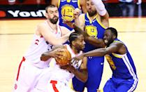 Kawhi Leonard #2 of the Toronto Raptors is defended by Draymond Green #23 of the Golden State Warriors in the second half during Game Two of the 2019 NBA Finals at Scotiabank Arena on June 02, 2019 in Toronto, Canada. (Photo by Vaughn Ridley/Getty Images)