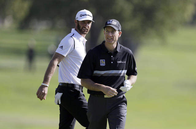 Jim Furyk, right, walks to the second green with Dustin Johnson in the first round of the Northern Trust Open golf tournament at Riviera Country Club in the Pacific Palisades area of Los Angeles Thursday, Feb. 13, 2014. (AP Photo/Reed Saxon)