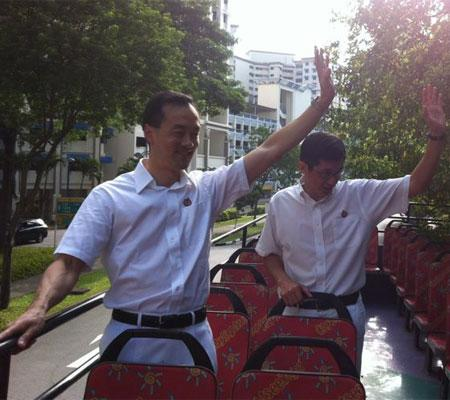PAP's Dr Koh Poh Koon and MP Teo Ser Luck on the parade vehicle. Koh says everyone did their best.