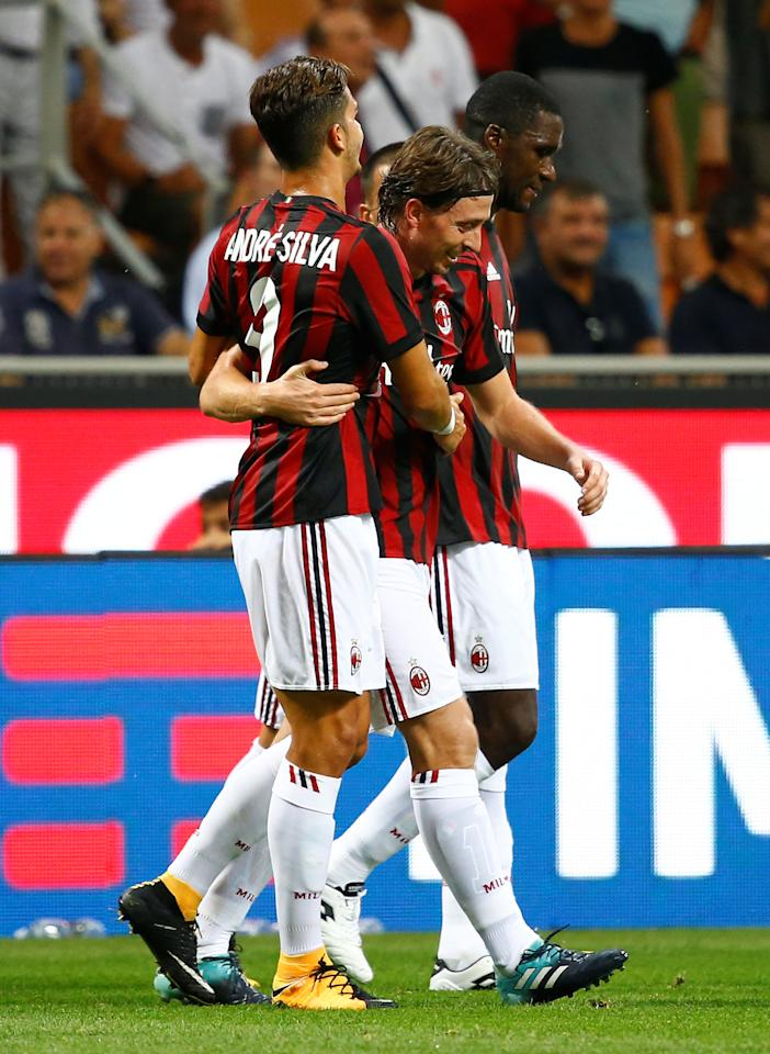 Soccer Football - Europa League - Playoffs - AC Milan vs KF Shkendija - Milan, Italy - August 17, 2017   AC Milan's Riccardo Montolivo celebrates scoring their second goal with Andre Silva    REUTERS/Stefano Rellandini