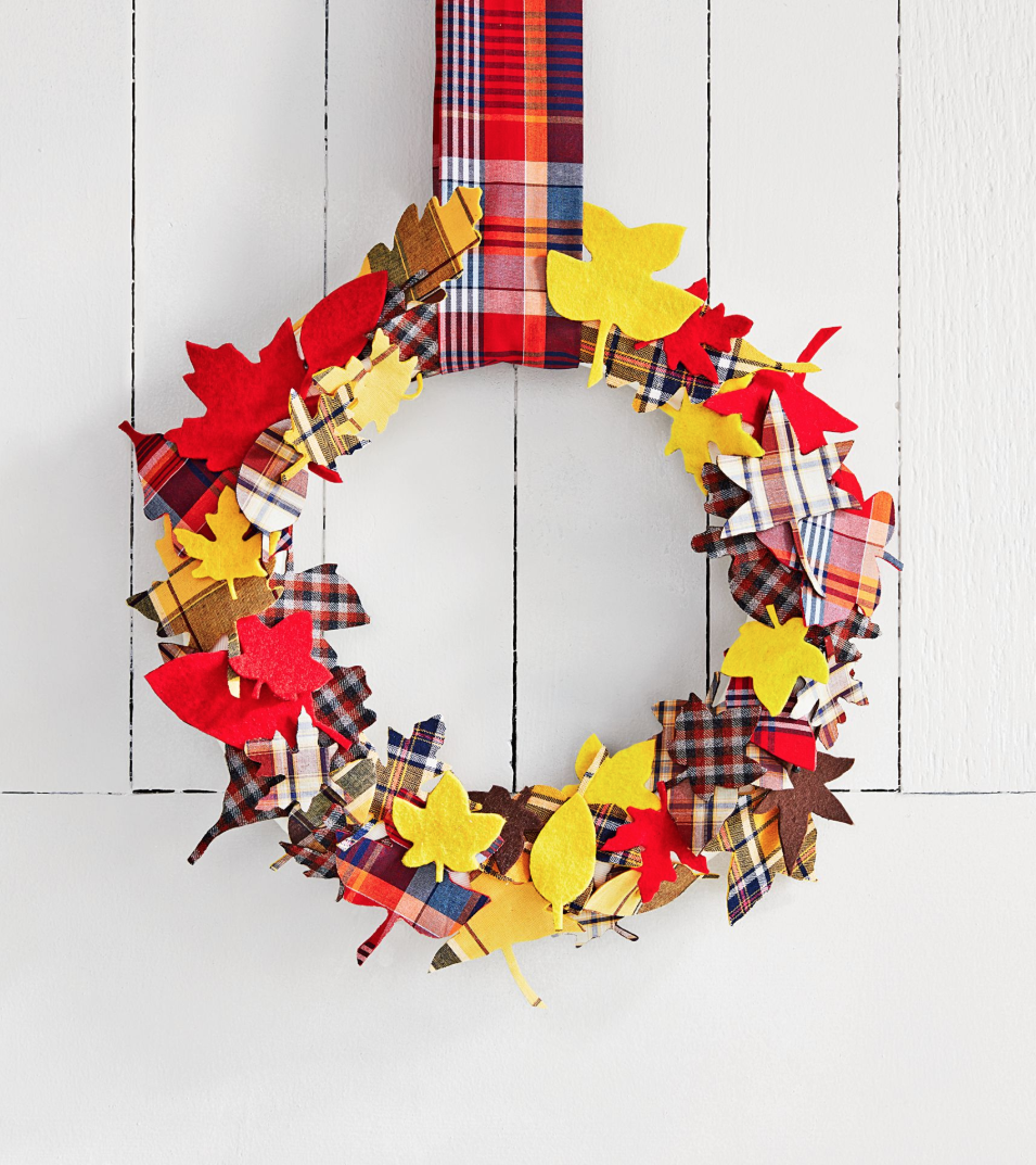 <p>Plaid shirts and autumn leaves go together like Thanksgiving and turkey! We love the idea of celebrating both of those fall staples in one cheerful wreath. </p><p><strong>Make the wreath: </strong>Trace leaf stencils onto double-stick fusible webbing, then fuse them to plaid fabric and cut out leaf shapes. Next, fuse the cutout leaves to felt, and cut out once more. Finally, wrap a foam wreath form with ribbon and attach the leaves with push-pins or hot glue, mixing the plaid and felt sides. Hang with a strip of plaid fabric. </p>