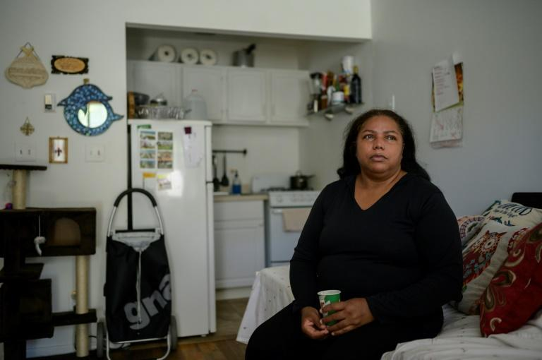 Rubiela Arias poses for a photo in the room she rents in Jackson Heights, in the New York borough of Queens, on May 27, 2021 (AFP/Ed JONES)