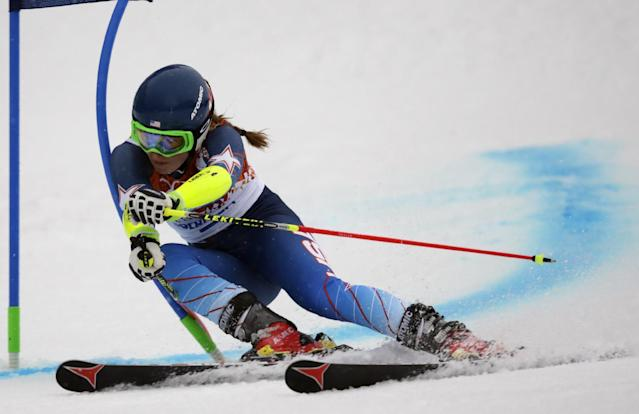 United States' Mikaela Shiffrin passes a gate in the first run of the women's giant slalom at the Sochi 2014 Winter Olympics, Tuesday, Feb. 18, 2014, in Krasnaya Polyana, Russia. (AP Photo/Charles Krupa)