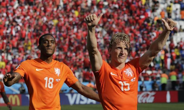 Netherlands' Dirk Kuyt, right, and Leroy Fer acknowledge the supporters after the group B World Cup soccer match between the Netherlands and Chile at the Itaquerao Stadium in Sao Paulo, Brazil, Monday, June 23, 2014. The Dutch team beat Chile 2-0 to top Group B. (AP Photo/Wong Maye-E)
