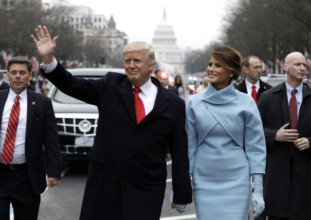 <p>U.S. President Donald Trump waves to supporters as he walks the parade route with first lady Melania Trump after being sworn in at the 58th Presidential Inauguration January 20, 2017 in Washington, D.C. Donald J. Trump was sworn in today as the 45th president of the United States (Evan Vucci/Getty Images) </p>