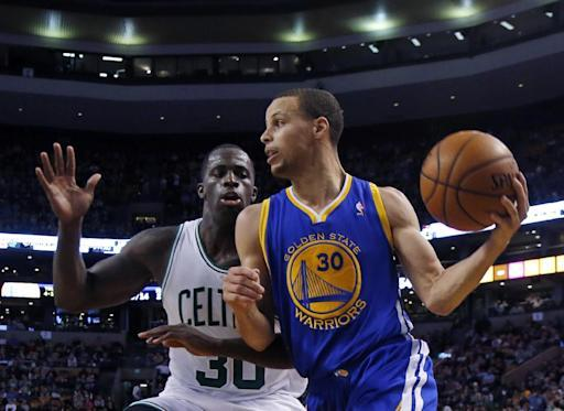 Golden State Warriors point guard Stephen Curry (30) controls the ball against Boston Celtics forward Brandon Bass (30) in the second half of an NBA basketball game in Boston, Wednesday, March 5, 2014. The Warriors won 108-88. (AP Photo/Elise Amendola)