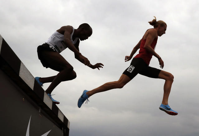 Evan Jager, right, clears the hurdle ahead of Hillary Bor in their heat in the men's 3,000-meter steeplechase at the U.S. Championships athletics meet, Friday, June 22, 2018, in Des Moines, Iowa. (AP Photo/Charlie Neibergall)