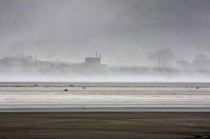 Wind blows salt from the bed of the dried-out Orumieh lake, northwest of Iran