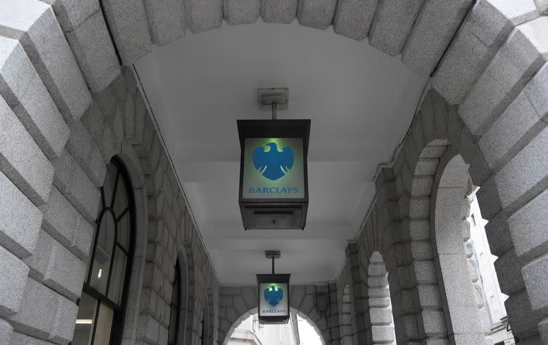 FILE PHOTO: The logo of Barclays bank is seen on glass lamps outside of a branch of the bank in the City of London financial district in London