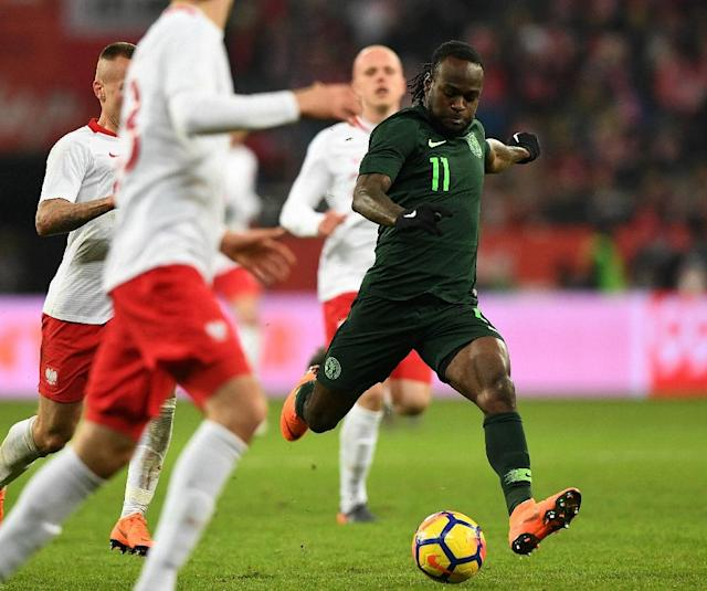Victor Moses converted a soft penalty he won himself in Poland (AFP Photo/JANEK SKARZYNSKI)