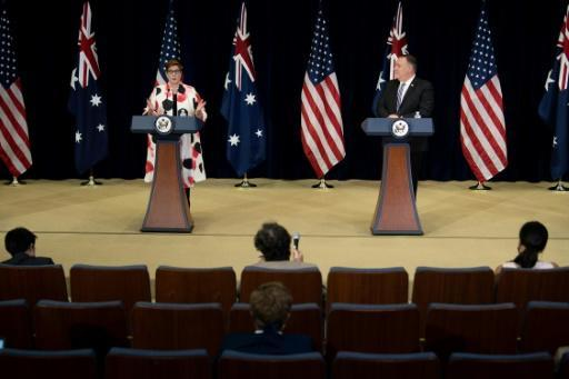 US Secretary of State Mike Pompeo listens while Australia's Foreign Minister Marise Payne speaks during a press conference