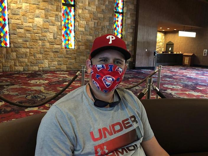 Andrew Payne, 33, traveled to Las Vegas for a bachelor party. He doesn't mind wearing a mask.