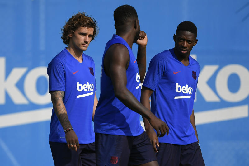 (L-R) Barcelona's French forward Antoine Griezmann, Barcelona's French defender Samuel Umtiti and Barcelona's French forward Ousmane Dembele arrive to the football club's first pre-season training session at the Joan Gamper training ground in Sant Joan Despi near Barcelona on July 15, 2019. (Photo by LLUIS GENE / AFP) (Photo credit should read LLUIS GENE/AFP/Getty Images)