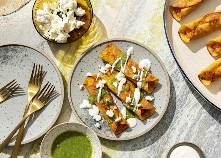 LOS ANGELES, CALIFORNIA, Aug. 25, 2021: Butternut Squash Flautas with Salsa Verde Cruda for the september Week of Meals collumn by Ben Mims, photographed on Wednesday, Aug. 25, 2021, at Proplink Studios in Arts District Los Angeles. (Photo and Prop Styling / Silvia Razgova / For the Times) ATTN: 829341-la-fo-week-of-meals-september-2021