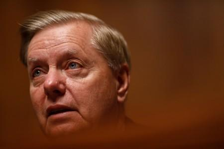 """Chairman Lindsey Graham speaks as FBI Director Christopher Wray testifies before a Senate Judiciary Committee hearing on """"Oversight of the Federal Bureau of Investigation"""" on Capitol Hill in Washington"""