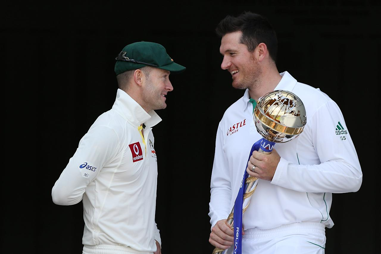 BRISBANE, AUSTRALIA - NOVEMBER 08:  Michael Clarke of Australia and Graeme Smith of South Africa pose with the ICC Test Championship Mace during a captain's media call at The Gabba on November 8, 2012 in Brisbane, Australia.  (Photo by Chris Hyde/Getty Images)