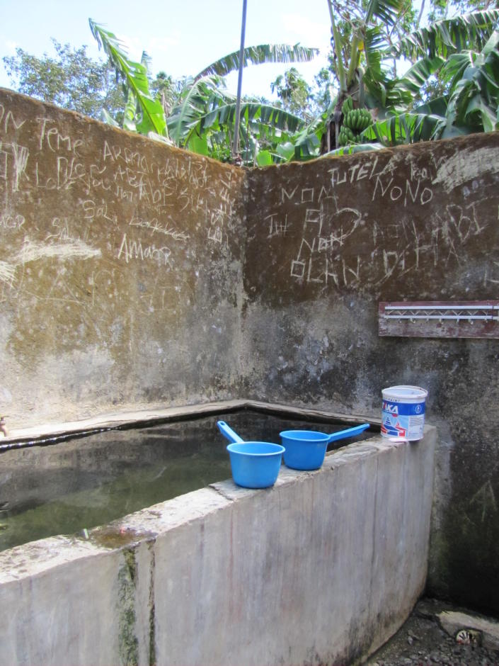 This 2017 photo provided to The Associated Press shows the bathing area at the Topu Honis children's shelter in Kutet, East Timor. All of the accusers said the Rev. Richard Dashbach regularly oversaw the girls' showers. They said all of the children removed their clothes and stood together naked around this large concrete water basin, with the nude priest going from girl to girl shampooing their hair and splashing water on their private parts. (AP Photo)