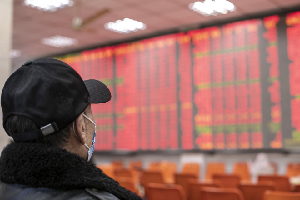 An investor watches an electric screen displaying stock price figures at a stock exchange hall in Shanghai, China. Photo: VCG/VCG via Getty