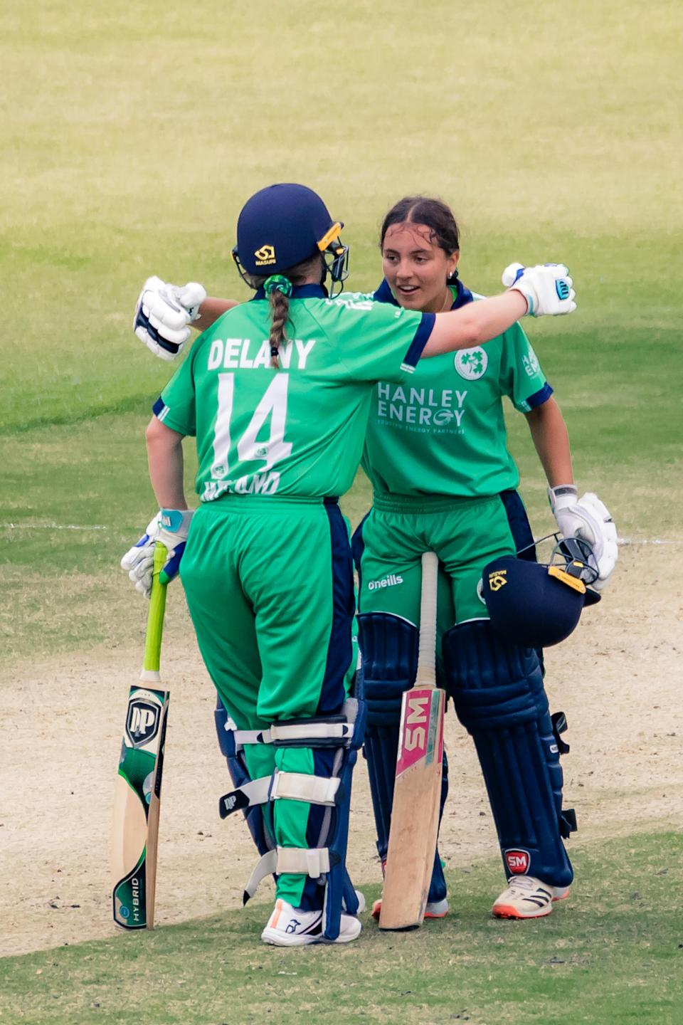 Amy Hunter celebrates her maiden century with her captain Laura Delany