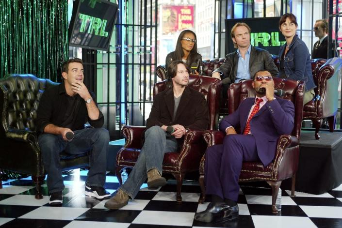 "<div class=""inline-image__caption""><p>Host Carson Daly interviews Jada Pinkett Smith, Hugo Weaving, Carrie-Anne Moss, Keanu Reeves and Laurence Fishburne during a visit from the cast of <em>The Matrix Reloaded</em> on MTV's Total Request Live May 13, 2003, at the MTV Times Square studios in New York City.</p></div> <div class=""inline-image__credit"">Scott Gries/Getty</div>"