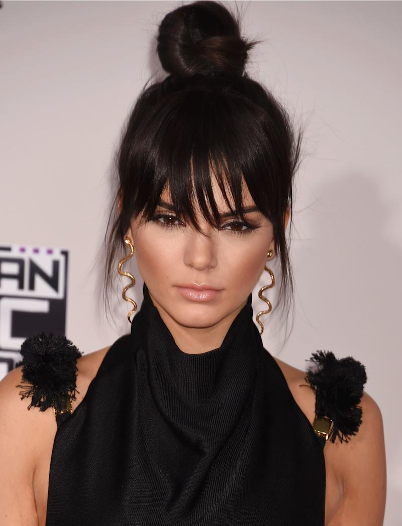 Jenner gets experimental, elevating her look with faux bangs and heavy contouring, for a more mature look at the American Music Awards in 2015.