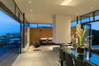 """<p>If you want to know how boujee people do coastal holidays, we have a feeling this is as close to it gets. </p><p>The main body of the house is a 'sun-filled quadruple aspect flowing space', according to the property's online description, which includes a sitting room, dining room and a stone clad kitchen. </p><p>The dining table sits eight, while the sheltered decking leads out to the garden and beach on either side of the house. This is open-plan living at its finest. A log fire sits proudly in the centre of the room and there's even an exterior warm shower if you like an early morning dip in the sea to awaken the senses. </p><p><strong>House for six people. Price bands vary depending on the season. A three night stay during winter starts at £630 for three nights. </strong></p><p><a class=""""link rapid-noclick-resp"""" href=""""https://www.paghambeachhouse.co.uk/house/"""" rel=""""nofollow noopener"""" target=""""_blank"""" data-ylk=""""slk:BOOK ONLINE"""">BOOK ONLINE</a></p>"""