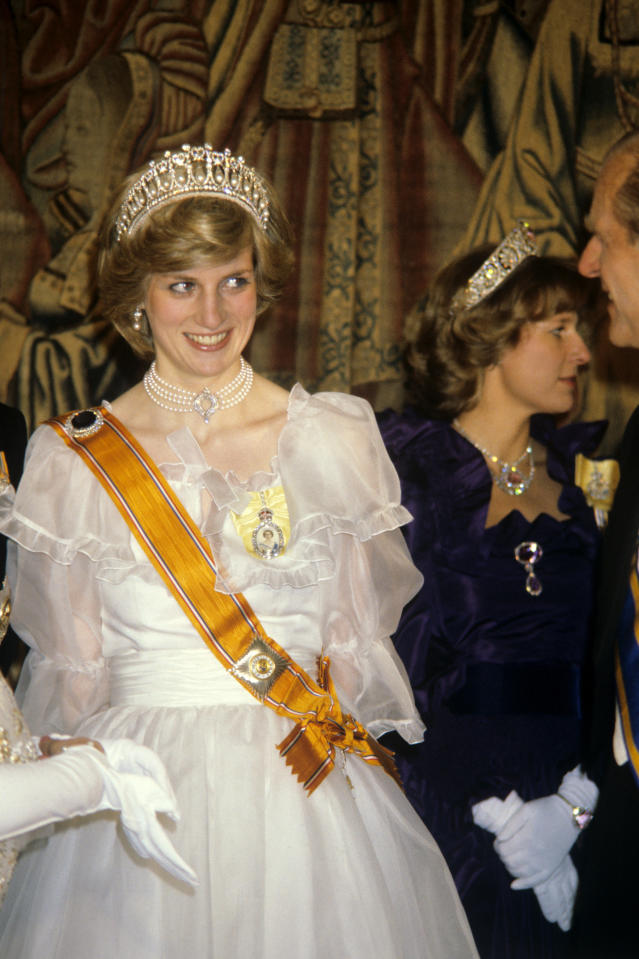 <p>Princess Diana donned a three-strand pearl necklace for a prestigious banquet in 1982. She borrowed the accessory from the queen before her majesty even had a chance to wear it. (Photo: PA) </p>