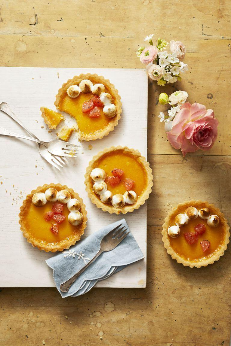 "<p>Sweeten up these tangy citrus tarts with sugar-packed meringue. </p><p><em><a href=""https://www.goodhousekeeping.com/food-recipes/dessert/a26767705/ruby-red-grapefruit-tartlets-recipe/"" rel=""nofollow noopener"" target=""_blank"" data-ylk=""slk:Get the recipe for Ruby Red Grapefruit Tarts »"" class=""link rapid-noclick-resp"">Get the recipe for Ruby Red Grapefruit Tarts »</a></em></p>"