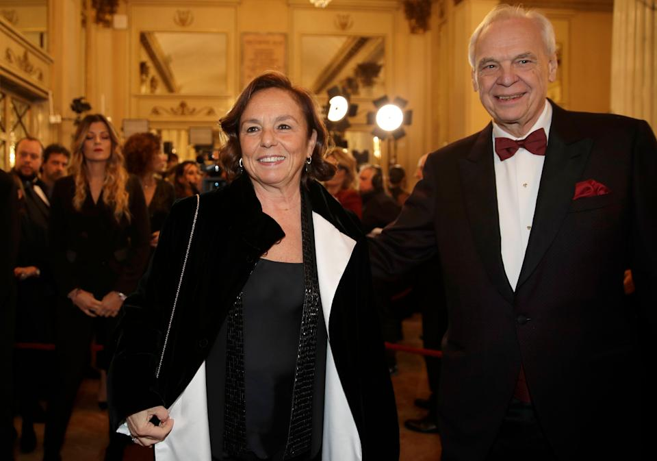 """La Scala general manager Alexander Pereira, right, welcomes Italian Interior Minister Luciana Lamorgese as she arrives for the gala premiere of La Scala opera house, in Milan, Italy, Saturday, Dec. 7, 2019. Milan's storied La Scala opens its 2019-2020 season on Saturday with Puccini's """"Tosca,"""" which stars Russian soprano Anna Netrebko as the object of unwanted sexual attention from a powerful authority figure. (AP Photo/Luca Bruno) (Photo: ASSOCIATED PRESS)"""