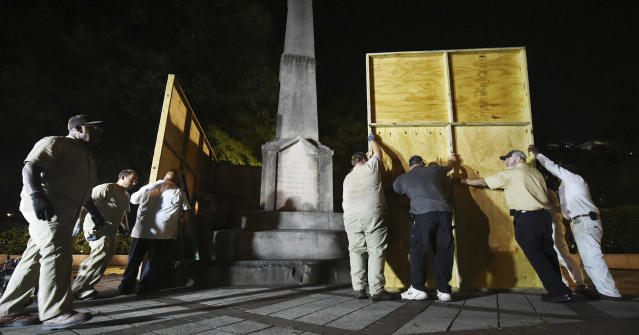 <p>Birmingham city workers use plywood panels to cover the Confederate Monument in Linn Park, in Birmingham, Ala., Aug. 15, 2017, on orders from Mayor William Bell. (Photo: Joe Songer/AL.com via AP) </p>