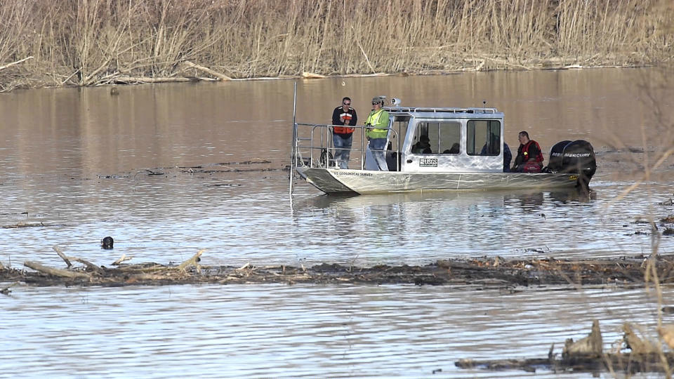 In this Wednesday, Dec. 4, 2019, photo, Missouri law enforcement personnel aided by the United States Geological Survey team use imaging sonar to try to locate the body of Mengqi Ji Elledge near Columbia, Mo. Divers searched for Elledge, in the Lamine River in Cooper County. Authorities say they have discovered human remains that they believe are the body of the Chinese woman who has been missing since October 2019. The remains were found Thursday, March 25, 2021 in Rock Bridge State Park in Boone County in mid Missouri. (Don Shrubshell/Columbia Daily Tribune via AP)