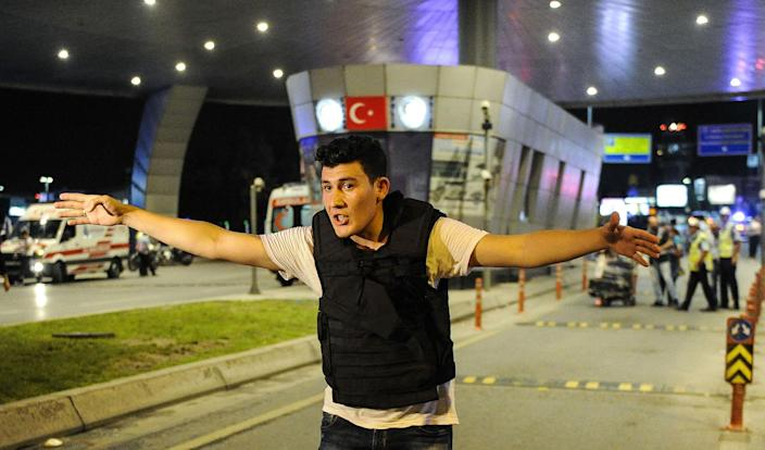<p>A Turkish police officer secures the entrance of the Turkey's largest airport, Istanbul Ataturk after the suicide bomb attacks, June 28, 2016, Turkey. (Gokhan Tan/Getty Images) </p>