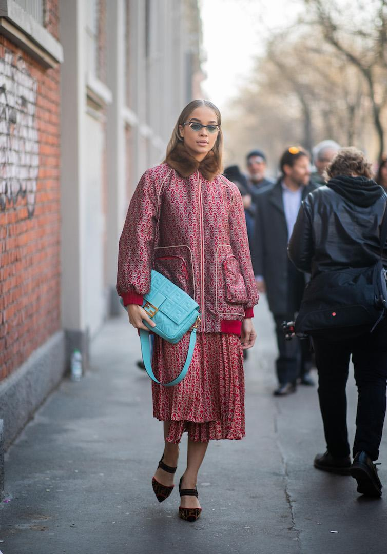 <p>Jasmine Sanders arrives at the Fendi show in a printed co-ord with a baby blue Fendi bag to hand. <em>[Photo: Getty]</em> </p>