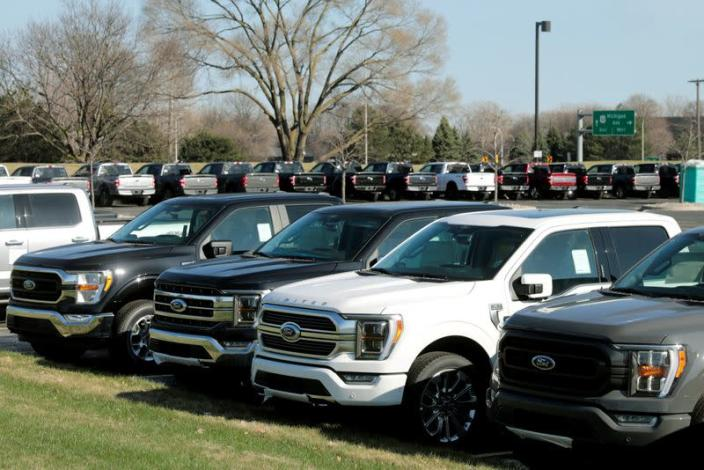 FILE PHOTO: Newly manufactured Ford Motor Co. 2021 F-150 pick-up trucks are seen waiting for missing parts in Dearborn