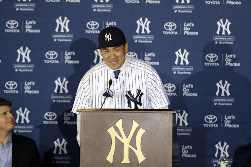 New York Yankees pitcher Masahiro Tanaka, of Japan, speaks as Yankees owner Hal Steinbrenner, left, watches him during a news conference at Yankee Stadium Tuesday, Feb. 11, 2014, in New York. (AP Photo/Frank Franklin II)