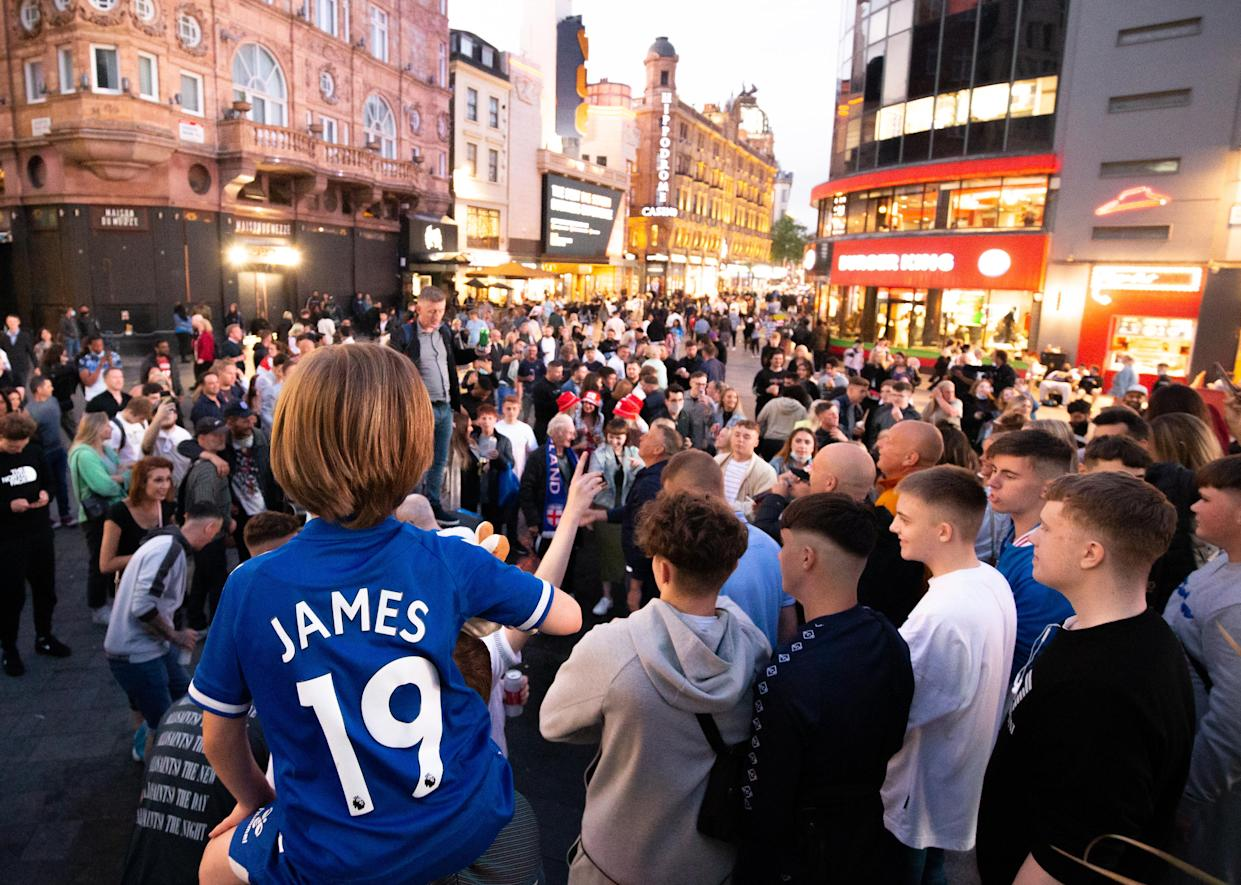 England fans singing in Leicester Square, central London, the evening before the England football team playing in the UEFA Euro 2020 Final. Picture date: Saturday July 10, 2021.