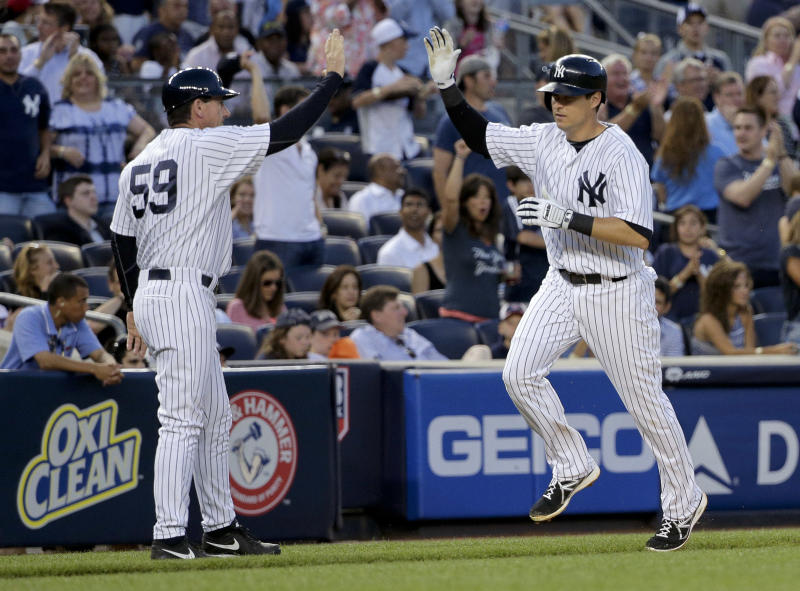 New York Yankees' Kelly Johnson, right, is greeted by third base coach Rob Thomson (59) as he rounds the bases after hitting a two-run home run against the Boston Red Sox in the fourth inning of a baseball game, Friday, June 27, 2014, in New York. (AP Photo/Julie Jacobson)