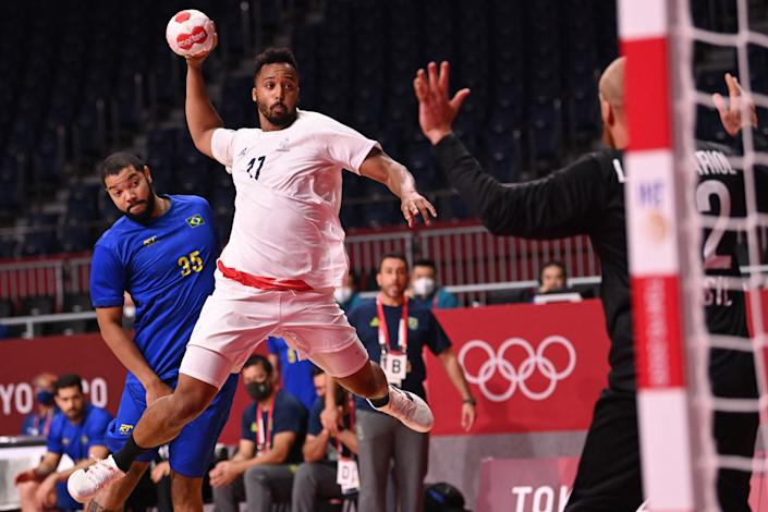 <p>France's left back Timothey NGuessan shoots during the men's Preliminary Round Group A handball match between Brazil and France of the Tokyo 2020 Olympic Games at the Yoyogi National Stadium in Tokyo on July 26, 2021. (Photo by Martin BERNETTI / AFP)</p>