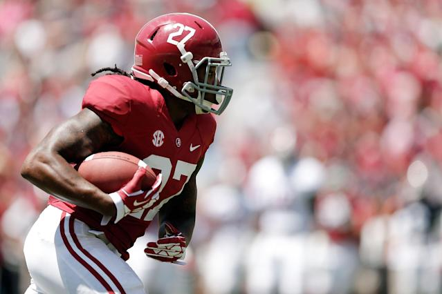 TUSCALOOSA, AL - APRIL 19: Derrick Henry #27 of the Crimson team runs for yards against the White team during the University of Alabama A-Day spring game at Bryant-Denny Stadium on April 19, 2014 in Tuscaloosa, Alabama. (Photo by Stacy Revere/Getty Images)