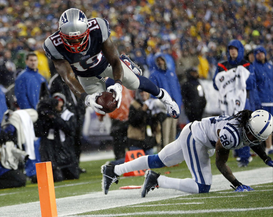 New England Patriots wide receiver Brandon LaFell (19) dives over Indianapolis Colts cornerback Greg Toler (28), but he had stepped out of bounds before reaching the end zone during the second half of the NFL football AFC Championship game Sunday, Jan. 18, 2015, in Foxborough, Mass. (AP Photo/Julio Cortez)