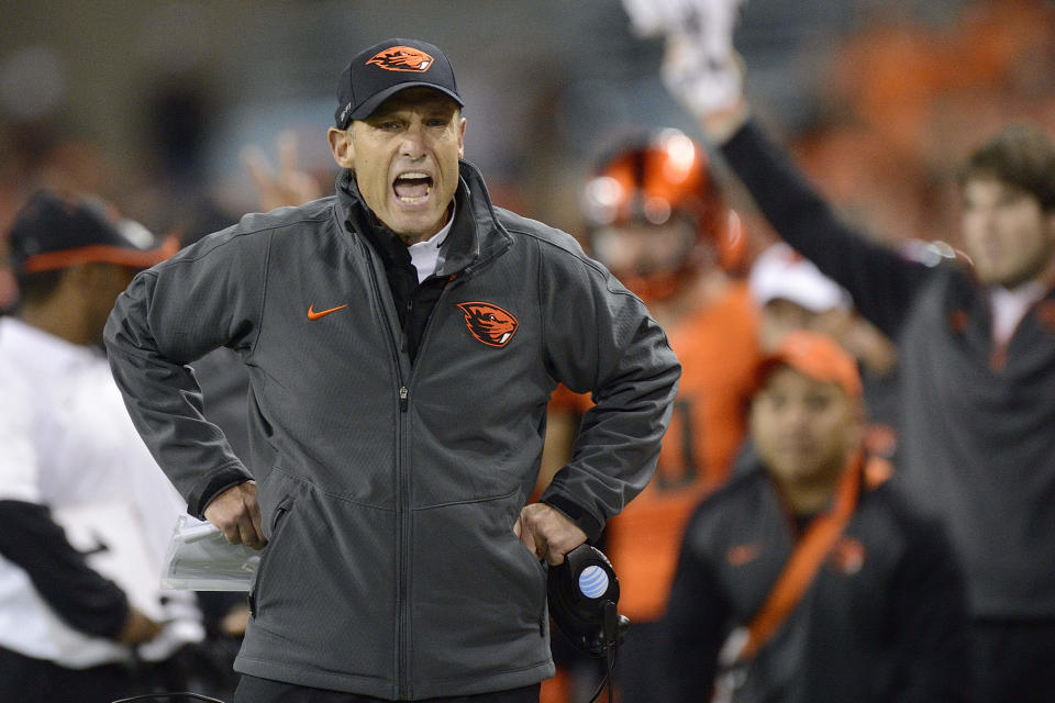 FILE - In this Oct. 16, 2014, file photo, Oregon State University football coach Mike Riley yells at an official during an NCAA college football game against of Utah in Corvallis, Ore. Nebraska has hired Riley as its new football coach on Thursday, Dec. 4, 2014, replacing the fired Bo Pelini. (AP Photo/Troy Wayrynen, File)