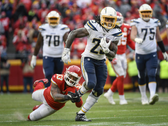 FILE - In this Dec. 29, 2019, file photo, Los Angeles Chargers running back Melvin Gordon (25) runs past Kansas City Chiefs inside linebacker Anthony Hitchens (53) during the second half of an NFL football game in Kansas City, Mo. The Denver Broncos continued an impressive offseason haul Friday, March 20, 2020, by agreeing to a two-year deal with former Los Angeles Chargers running back Melvin Gordon. (AP Photo/Reed Hoffmann, File)