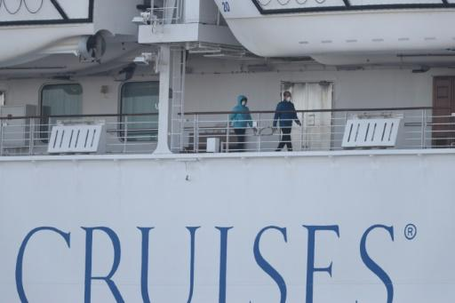 Passengers have been allowed to walk on the deck of the virus-hit Diamond Princess if they wear face masks