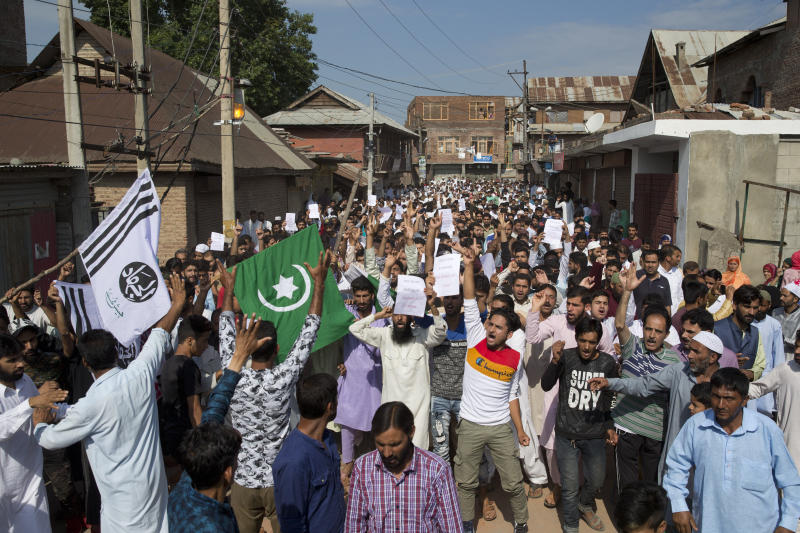 "FILE - In this Monday, Aug. 12, 2019 file photo, Kashmiri Muslims shout ""We want freedom"" and ""Go India, Go back,"" during a protest after Eid prayers during a security lockdown in Srinagar, Indian controlled Kashmir. Gulf Arab countries have remained mostly silent as India's government moved to strip the Indian-administered sector of Kashmir of its limited autonomy, imposing a sweeping military curfew in the disputed Muslim-majority region and cutting off residents from all communication and the internet. (AP Photo/ Dar Yasin, File)"