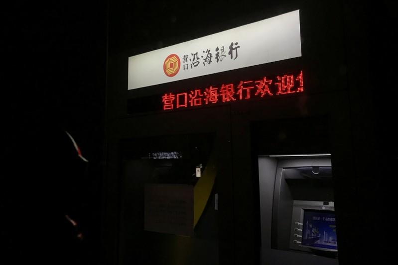 Automated teller machine (ATM) of Yingkou Coastal Bank is seen at its branch in Yingkou