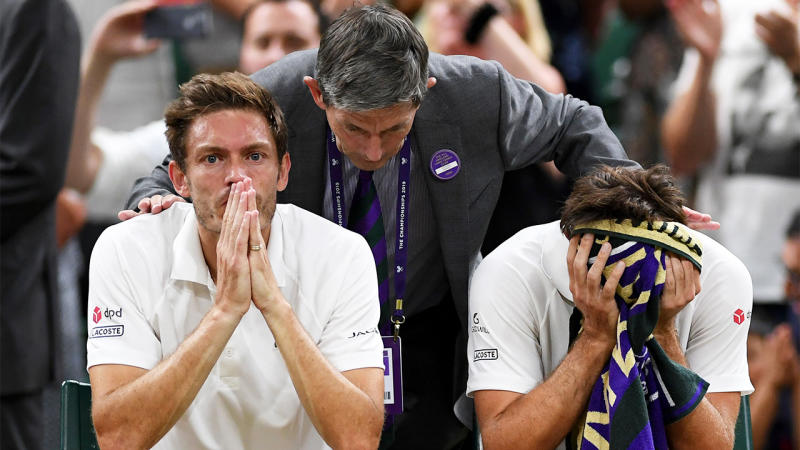 Edouard Roger-Vasselin of France and playing partner Nicolas Mahut of France react following defeat in their Men's Doubles final against Robert Farah of Colombia and Juan Sebastian Cabal of Colombia during Day twelve of The Championships - Wimbledon 2019 at All England Lawn Tennis and Croquet Club on July 13, 2019 in London, England. (Photo by Shaun Botterill/Getty Images)
