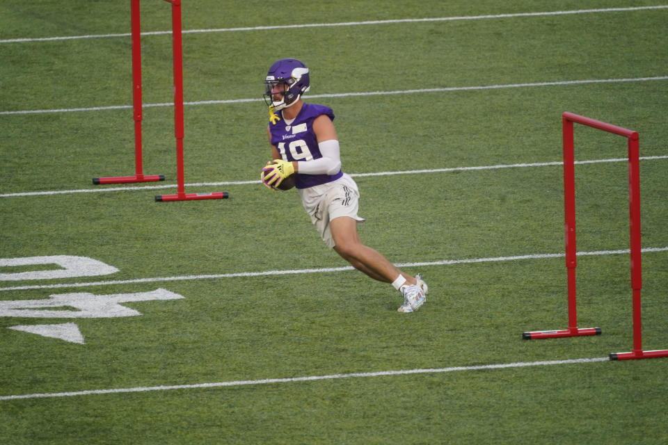 Minnesota Vikings wide receiver Adam Thielen (19) carries the ball during the team's Back Together Day at NFL football training camp at TCO Stadium, Saturday, July 31, 2021, in Eagan, Minn. (AP Photo/Jim Mone)